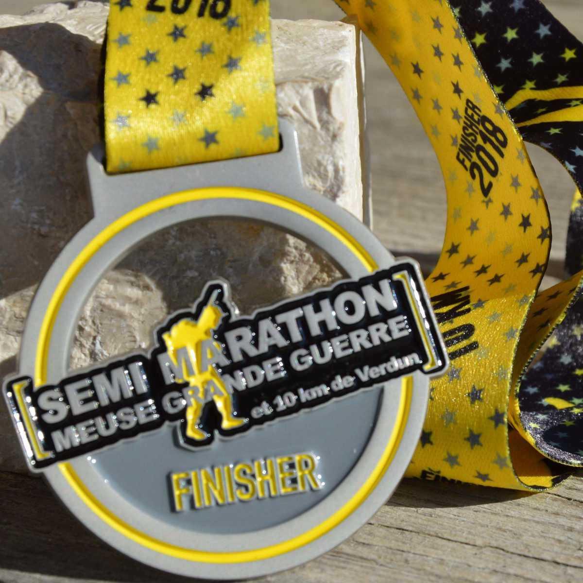 Médaille finisher ronde réalisée pour le semi-marathon de Verdun - Meuse Grande Guerre