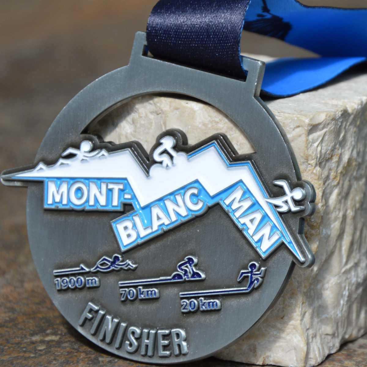 Médaille Finisher ronde créée pour le Triathlon Mont-Blanc Man